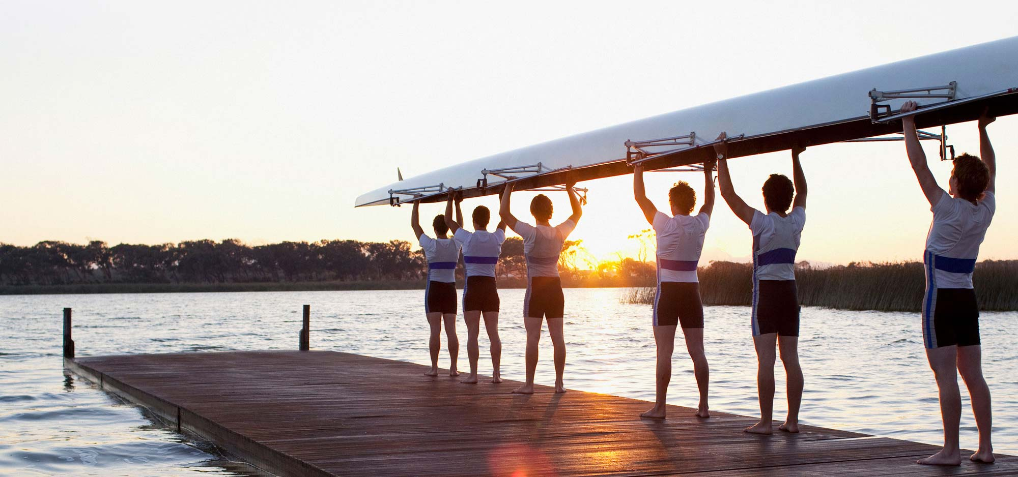 rowers holding up boat